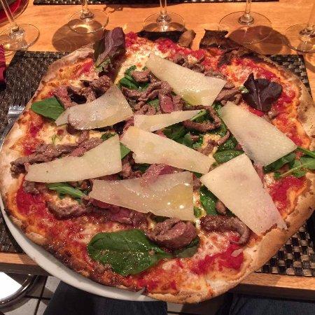 Sirloin steak pizza and parmesan flakes. ONLY AT LA LANTERNA