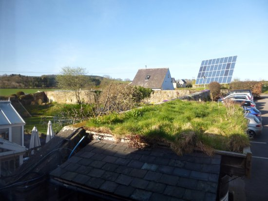 Wark, UK: Solar panels, green roof and part of the garden