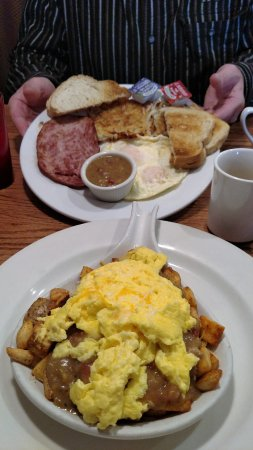 Mountain Home Cafe Inc. : Skillet with scrambled eggs and green chili....ham steak and eggs. Coffee!