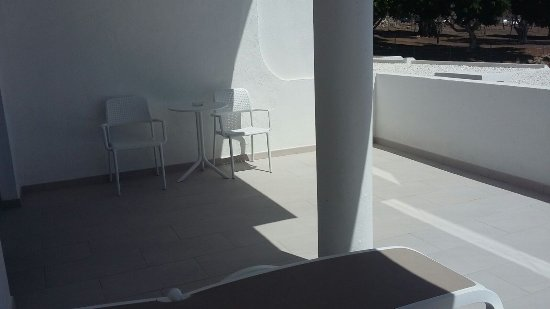 Massive balcony with two sunbeds, two chairs and table - Picture of ...