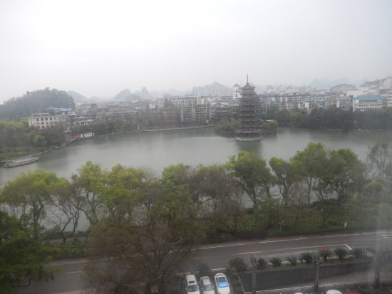 Lijiang Waterfall Hotel: It was a rainy day and the fog was obscuring some of the view but still beautiful!