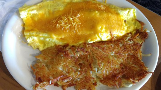 Bellflower, CA: Eggs in hash brown with wonderful salsas to try.