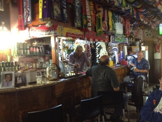 Sliema, Malta: Joe behind the bar, in the Changes Bar, complete with soccer scarves!