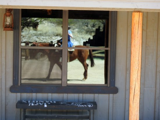 Tombstone Monument Ranch: riding home, reflected in the windown