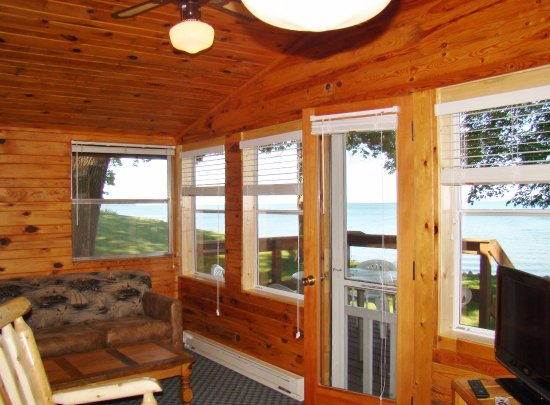 Walker, MN: The Beach House living area with a wall of windows overlooking the beach and the lake.