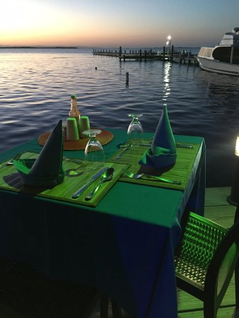 South Water Caye, Belize: Our table every night for dinner. Loved the lighting and the glow.