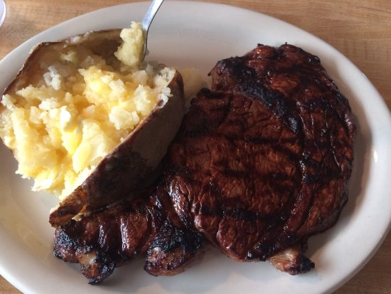 Columbus, MS : Large rib eye medium rare with baked potato with butter