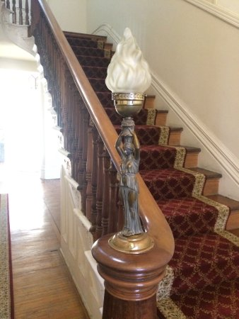The Ragland Mansion B&B and Events: Artwork on the stairway banister.