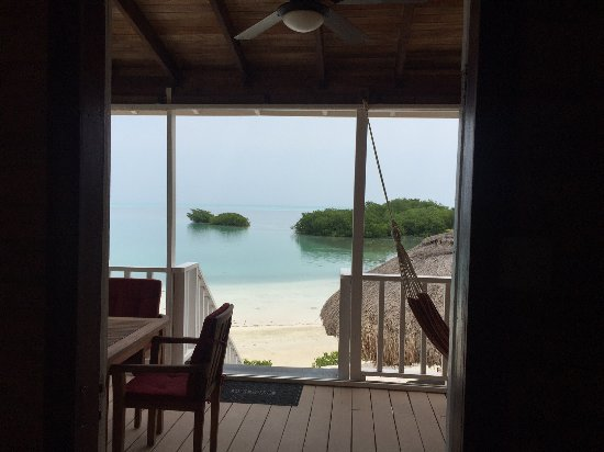 Royal Palm Island Resort: The view from the doorway of our cabana out the back to the beach.