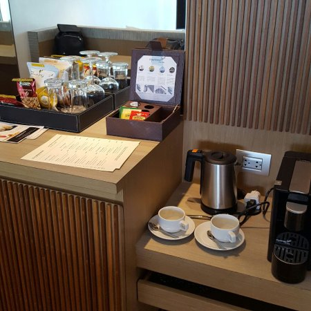 Mini bar complete with coffee soft drinks snacks and for Mini coffee bar