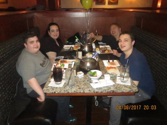 The Melting Pot: The four of us about to enjoy another great meal here.