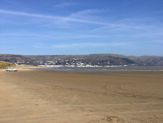 Borth, UK: View of Aberdovey across the Dovey Estuary from the flat sands at the nature reserve.