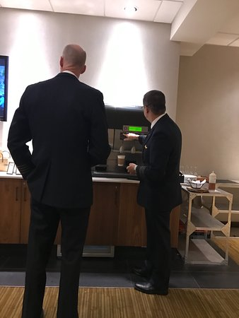Rye Brook, NY: Unsuccessfully trying to get the executive lounge coffee machine to work