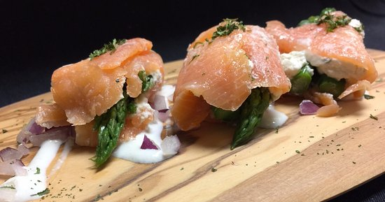 Garden City Steak & Grill: Our newest appetizer- Fresh asparagus wrapped in smoked salmon & Boursin cheese.  Delicious!