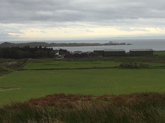 Port Ellen, UK: A shot looking down on the distillery from Laphoraig's water source.