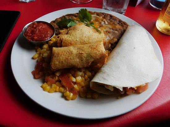 Gina's Mexican Cafe: Beans were luke warm and just plopped on the plate...too much corn as well.