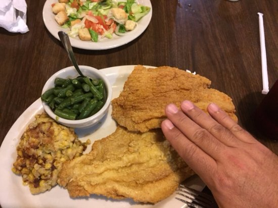 Alvin, TX: Huge Catfish fillets ( hand for size comparison) with homemade corn casserole and green beans.