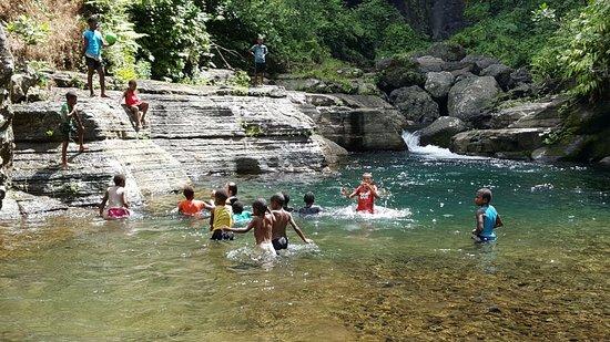 Suva, Fiji: village kids having fun in the pool