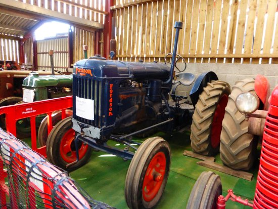 Raglan, UK: Collection of tractors / farm machinery