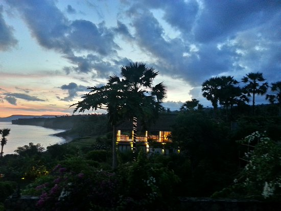 Shunyata Villas Bali: View from villa terrace: cliff, infinity swimming pool, restaurant.