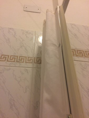 Hotel Astra : Old furniture, bathroom door self made of shower curtain ?! Toilet small and old ...