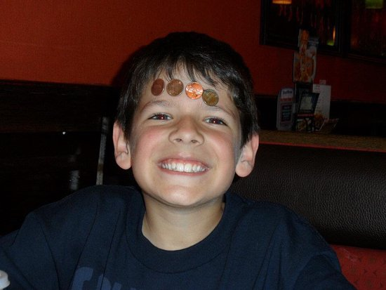 Applebee's: Having fun sticking the coins on his head - please don't ask why we don't but he was happy doing