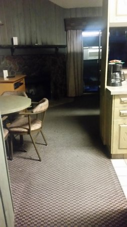 Douglas Fir Resort & Chalets: Small kitchen table to the left and stove and fridge to the right