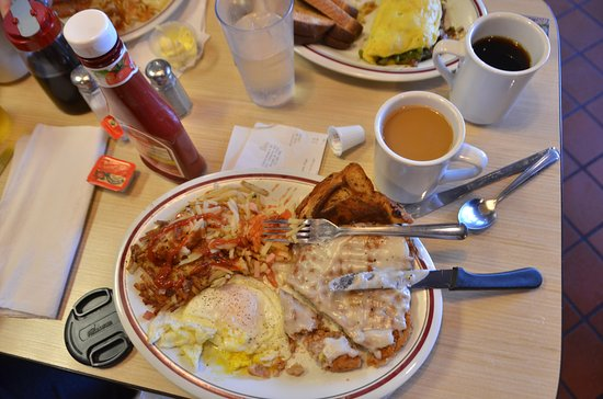 Douglas, GA: Loaded hash browns, eggs over easy, chicken fried steak cinnamon raisin toast, and good coffee