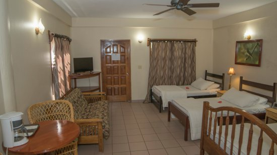 Burrell Boom, Belize: River view room with 2 single, a queen bed and a futon.