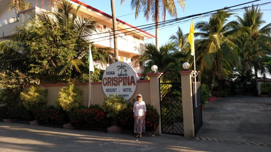Dona Crispina Resort and Hotel: Jo standing at the signage entrance