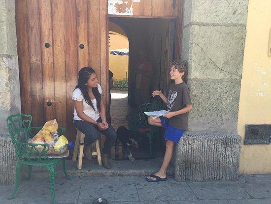 Oaxaca, México: Estefania y my son at the front door of the school enjoying a beautiful day.