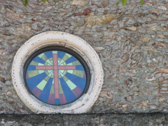 Boac Cathedral : stained glass window set in the rock work