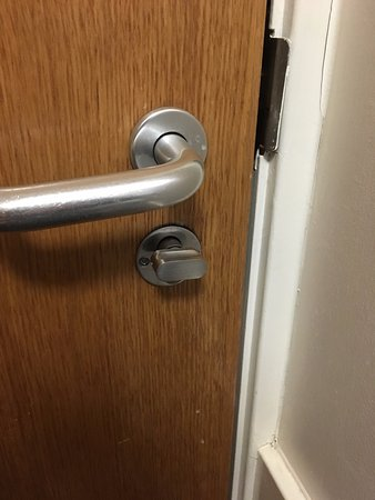 Turning this knob to the right did not lock the door, so anyone with ...