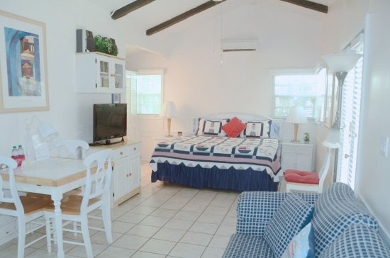 Cottages by the Ocean: King studio with king bed, vaulted ceilings, comfortable space.