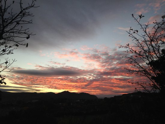 Bodysgallen Hall & Spa: Sunset over the Conwy valley from hotel grounds beyond walled garden