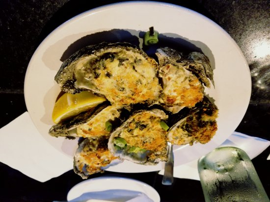 A.W. Shuck's : Oysters Romano a spin on the Rockefeller classic.. 6 or 12 using James River Oysters