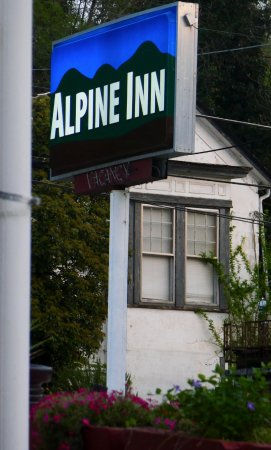 Alpine Inn: Sign during the day.