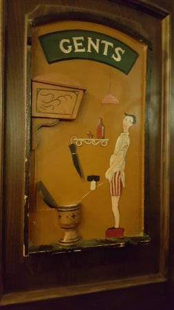 Zur Letzten Instanz: gents toilet door with comical frieze