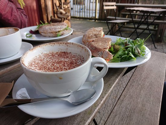 Coalbrookdale, UK: Cappuccino and sourdough sandwich; this was out on the covered decking - blankets provided!