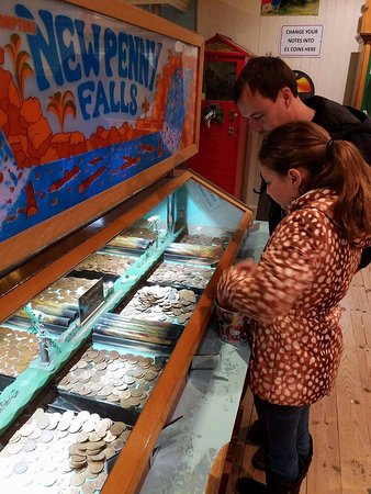 Wookey Hole Old Penny Pier Arcade: new penny falls
