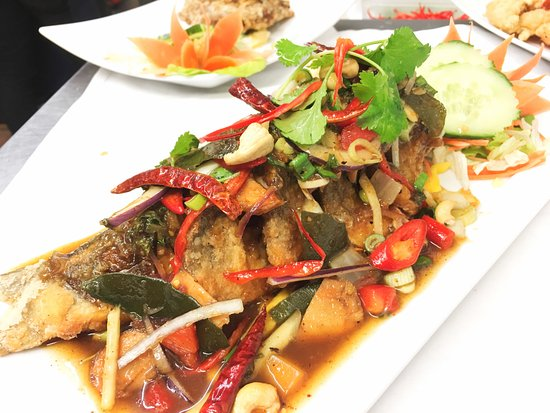 Ims's Thai Kitchen: PLA LUI SUAN is deep fried sea bass top with homemade sauce and mixed thai herbs