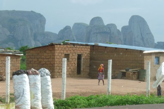 Malanje, Angola: charcoal for sale with Black Rocks background