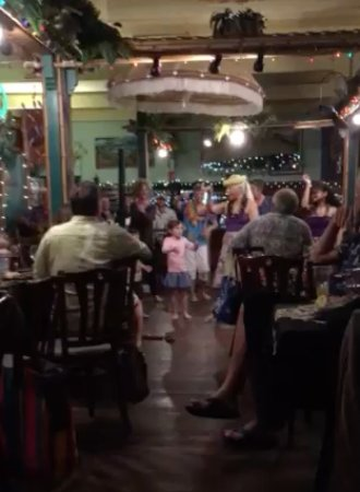 Bamboo Restaurant: This is a screen shot from a video but it shows the hula dancer and the kids dancing with her.