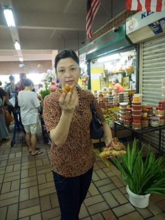 LaZat Malaysian Cooking Class: Ana showing us different ingredients during the market tour