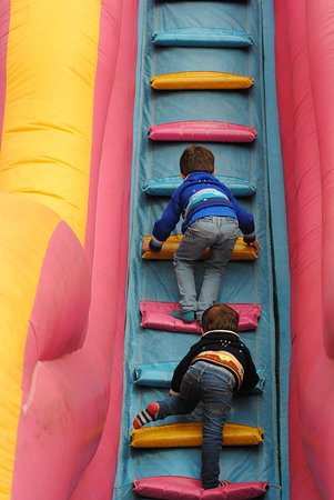 Pembrey, UK: Climbing an inflatable staircase