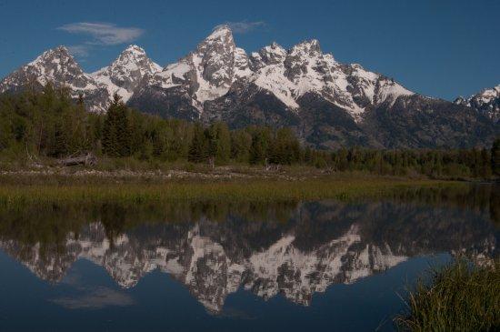 Early morning reflection of Grand Tetons and Jackson Lake
