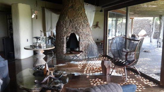 Singita Boulders Lodge: living area with bedroom and bathroom beyond