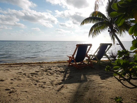 Laru Beya Resort & Villas: The chairs and ocean view just off our private patio.
