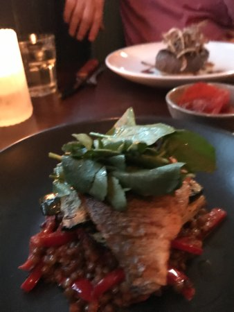 Sunninghill, UK: Sea bass with lentils (I liked) and distant Steak Rossini (but disappointing) with toasted onion