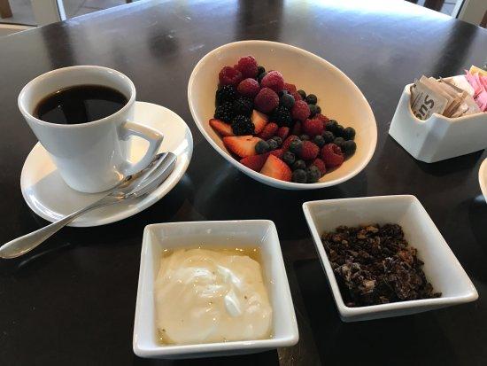JUST Inn: Part one of breakfast: Yogurt, lotsa berries, and granola (chocolate today)
